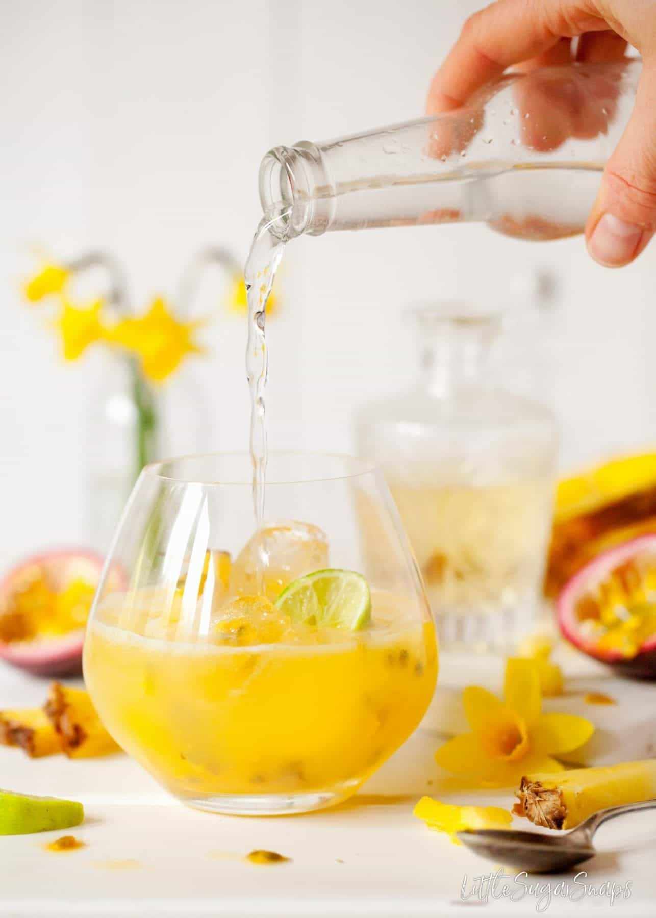 Passionfruit and Pineapple Spring Gin & Tonic being poured.