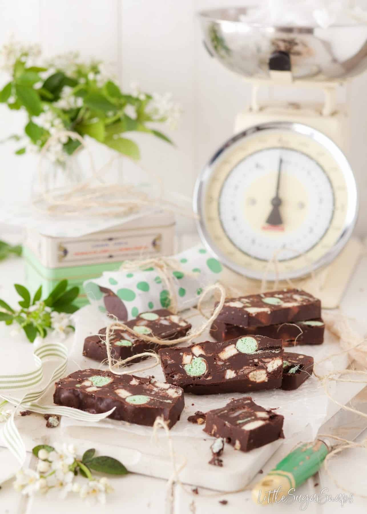 Slices of Mint Chocolate Fridge Cake with old fashioned kitchen scales behind.