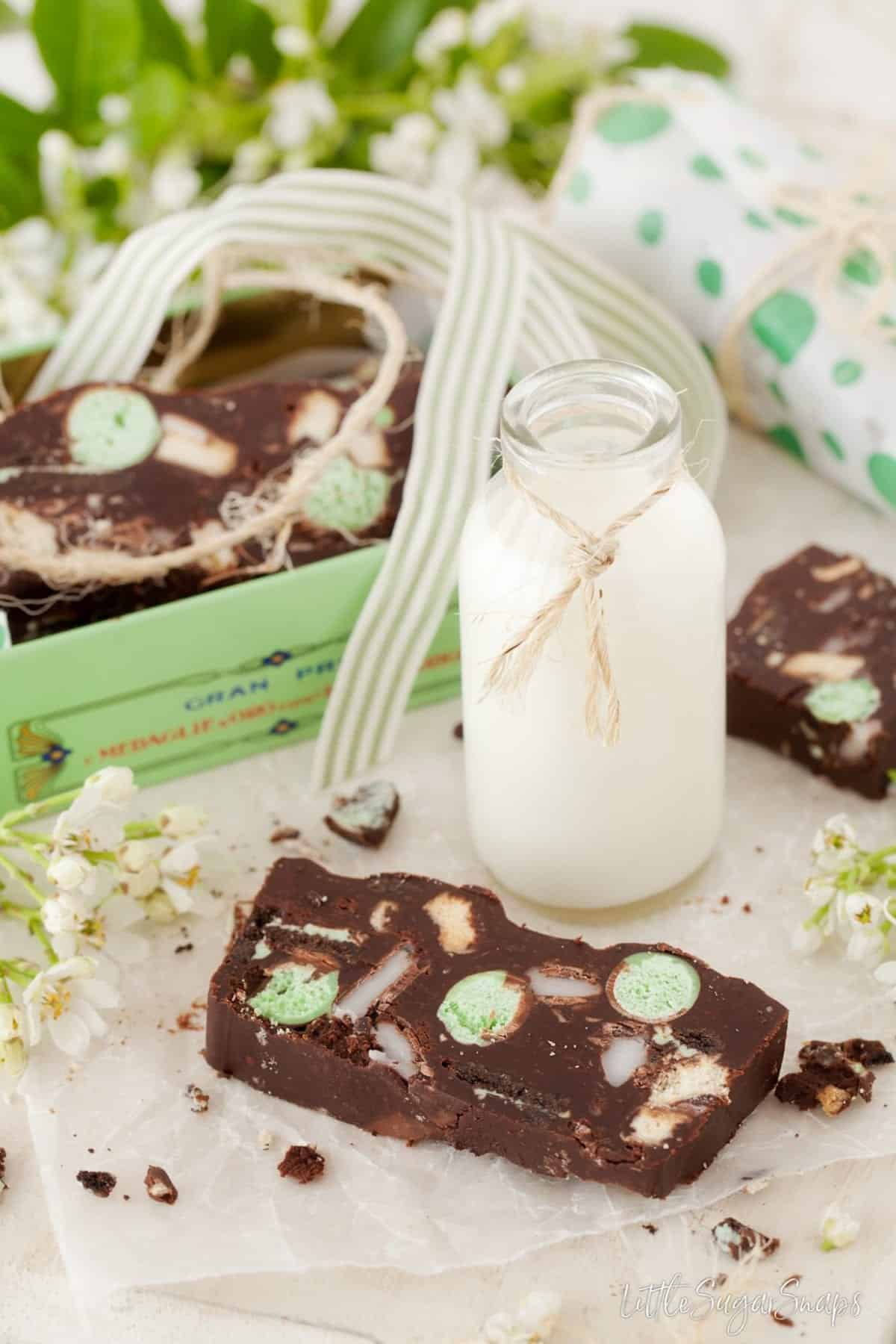 A mint aero slice with a small bottle of mint.