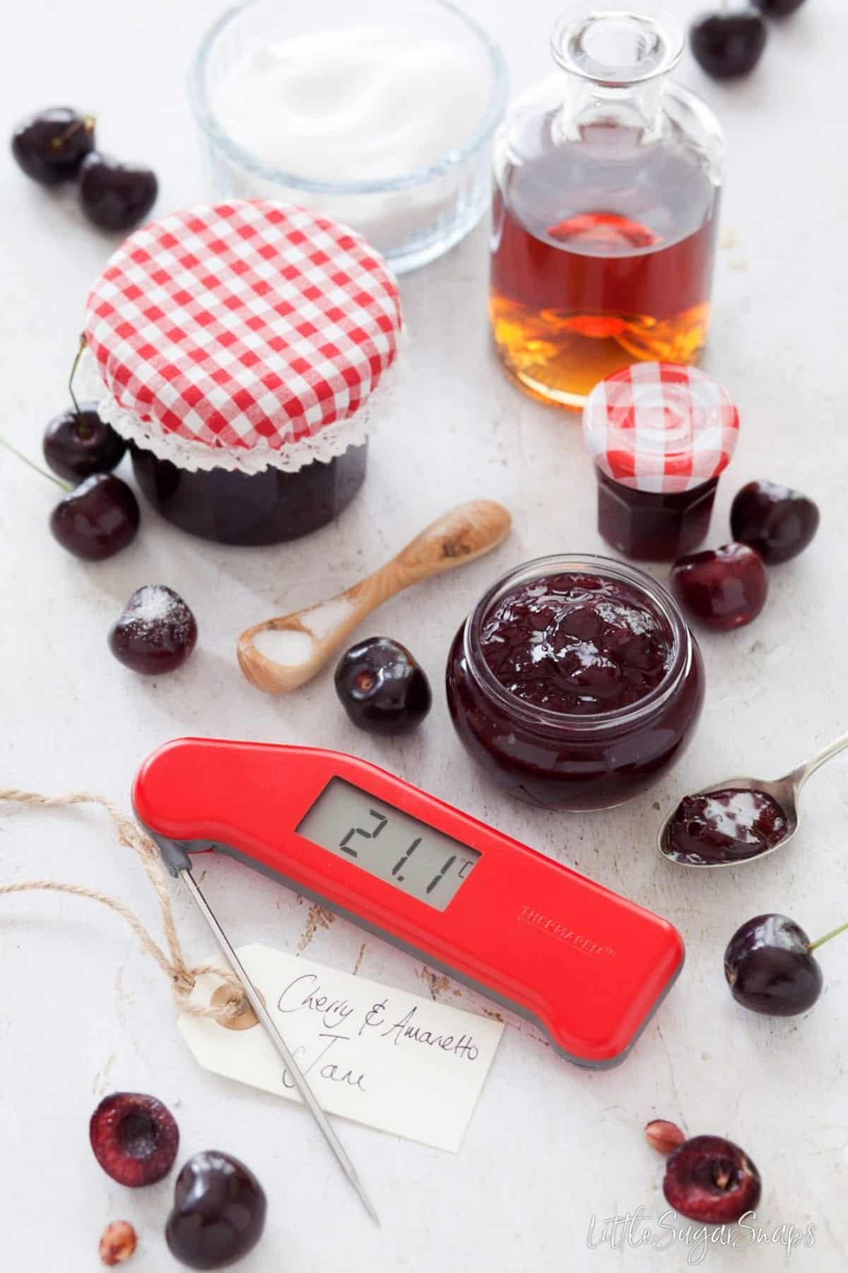 Amaretto Cherry Jam with fresh cherries and a digital food thermometer