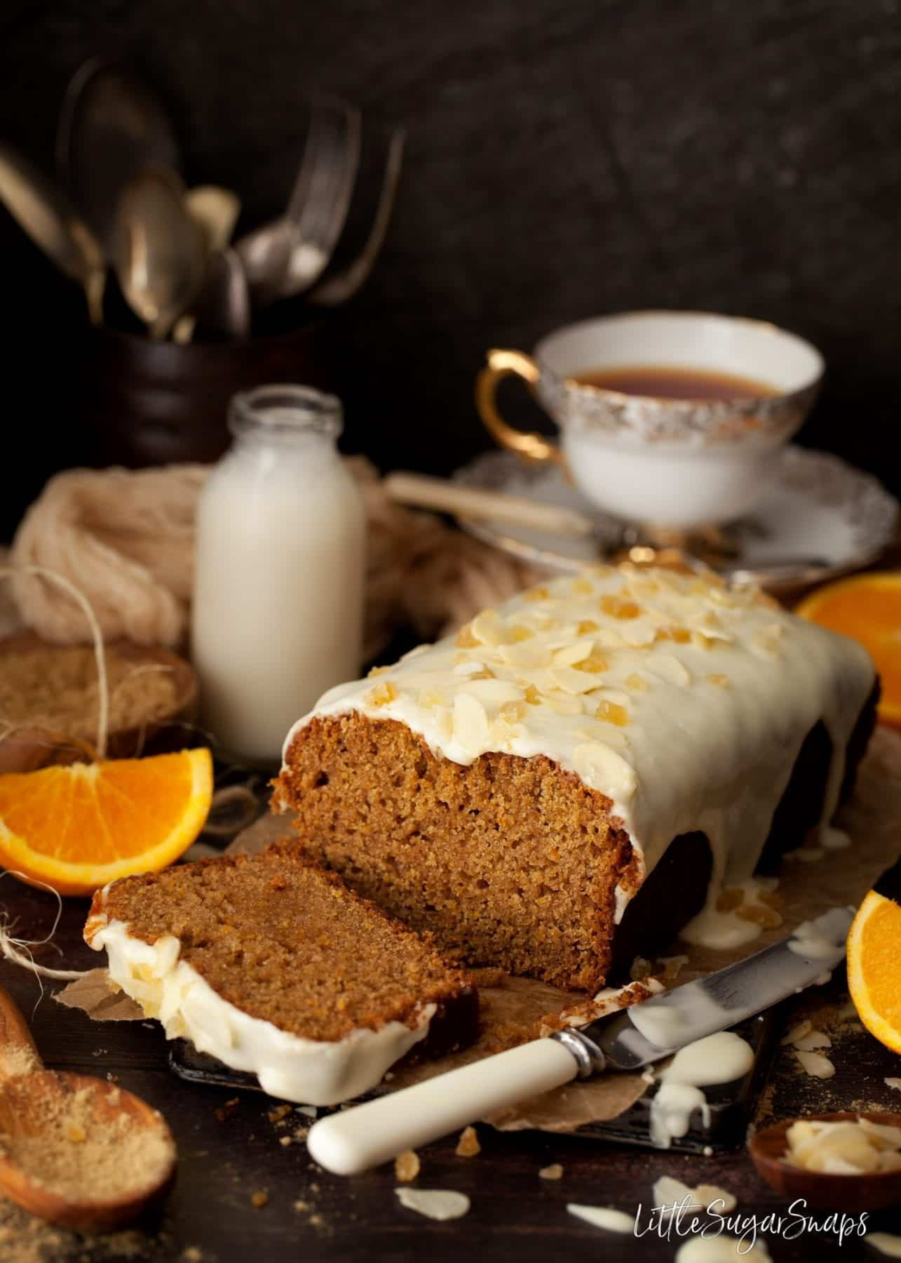 Freshly cut sweet loaf cake served with tea