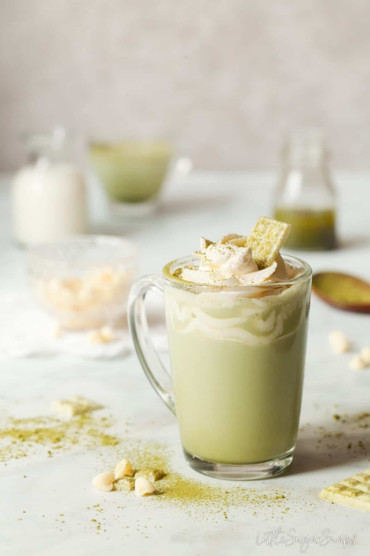 Chocolate matcha in a heatproof glass with whipped cream