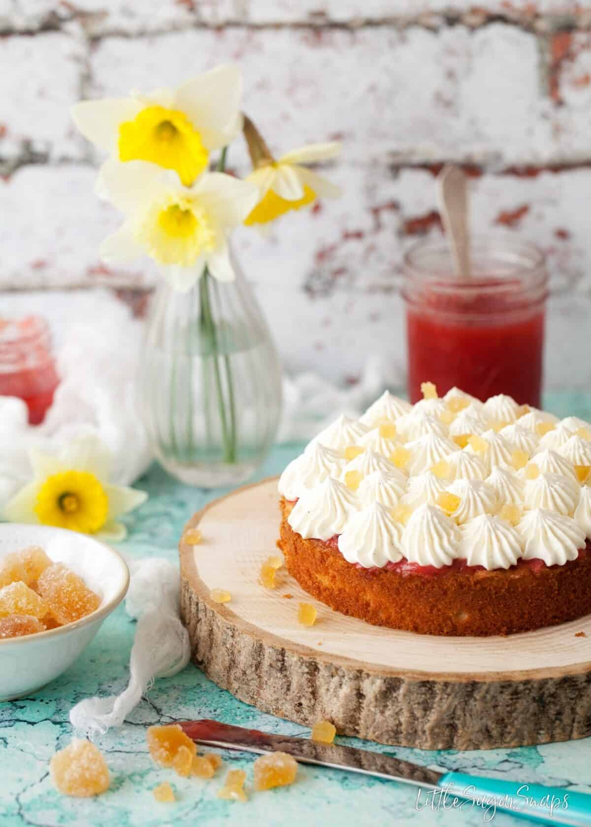 Easy Vanilla Sponge Cake being filled with jam and cream.