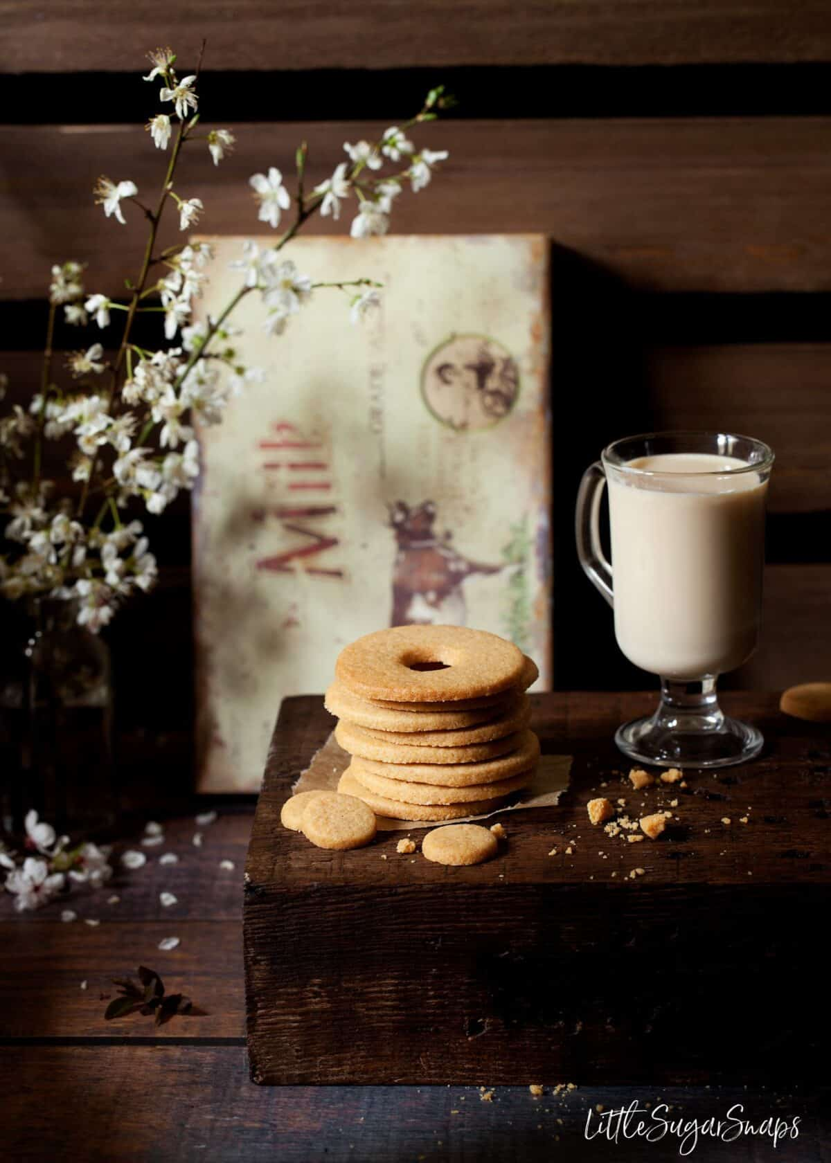 A stack of Malted Milk Biscuits on a wooden board.