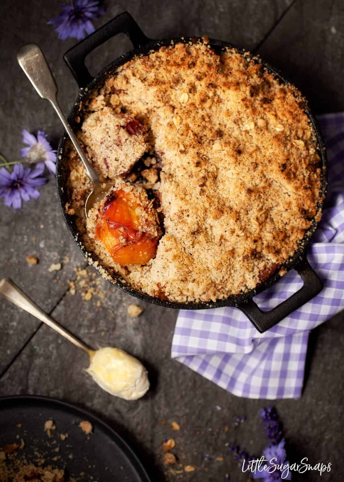 Bourbon Peach Crisp in a cast iron skillet