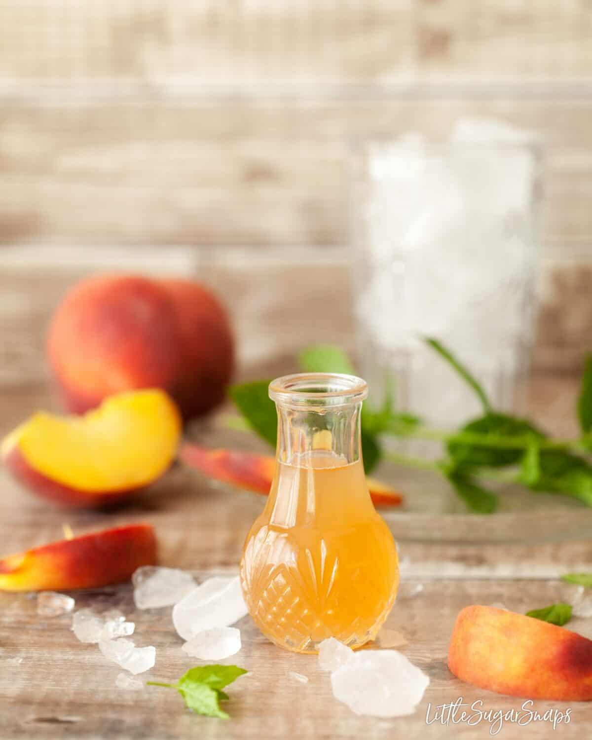 homemade peach syrup in a glass bottle