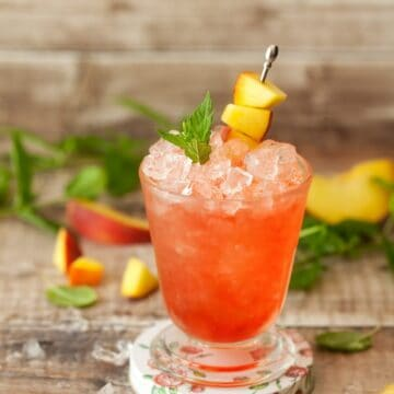 A summer twist on the gin bramble made with raspberry and peach