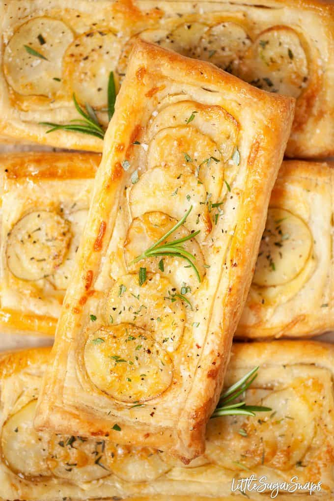 Close up image of brie and potato tarts with rosemary and sea salt on top