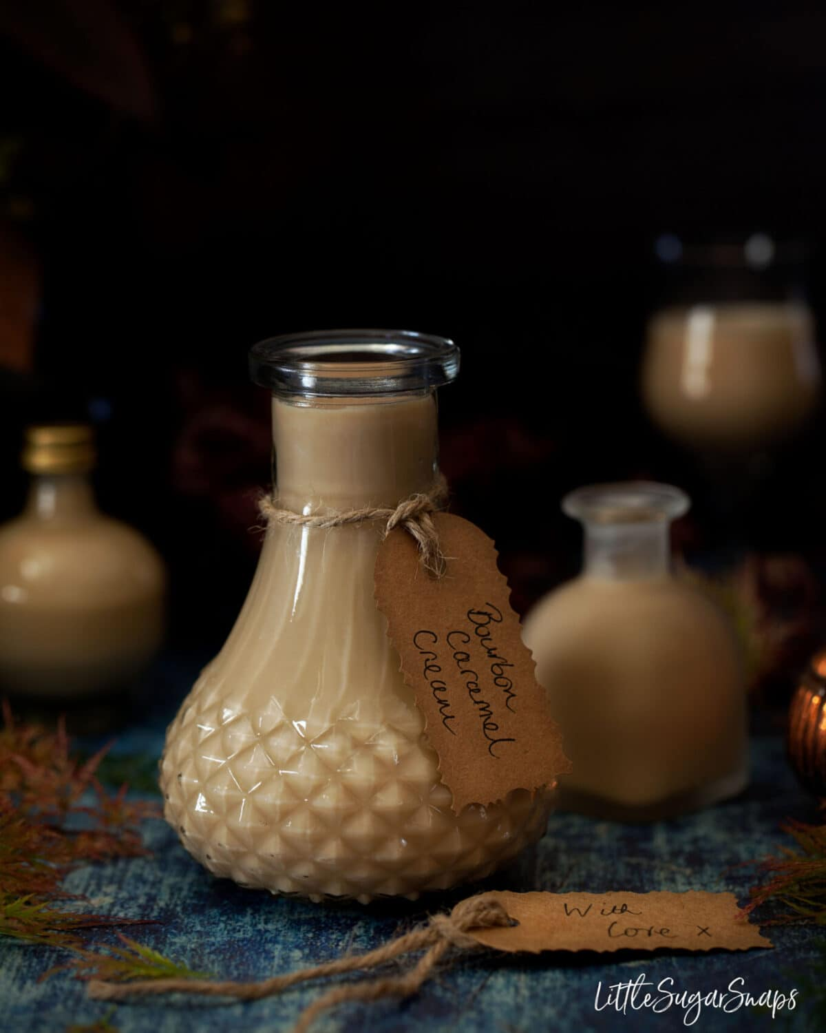 Small bottles of caramel cream liqueur with gift tages