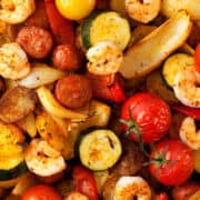 Sheet Pan Chorizo and Prawns with courgette, peppers, onion and tomatoes