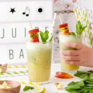 Apple juice with fruit kebabs