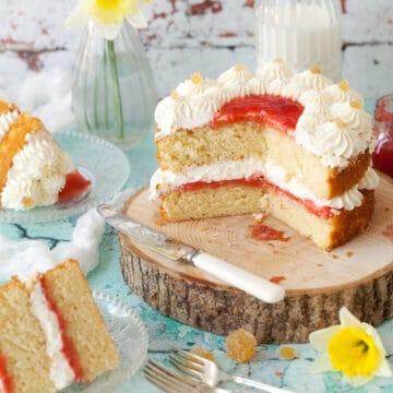 Two layer vanilla sponge cake with cream and jam