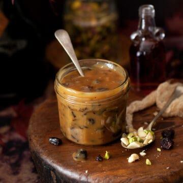a jar of caramel sauce with dried fruit