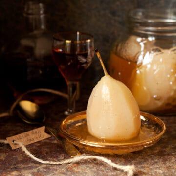 A poached pear in vanilla Amaretto syrup