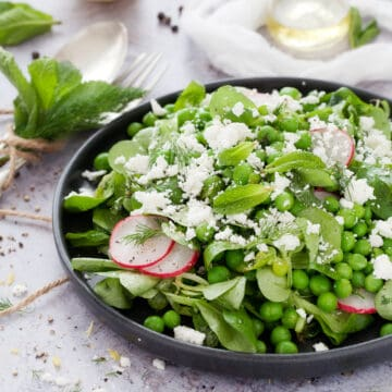 pea and mint salad with goats cheese on a plate