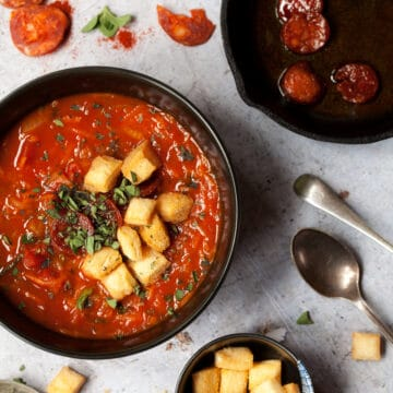 tomato soup with croutons, chorizo and herbs