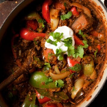 vegetarian rogan josh curry with aubergine and black lentils