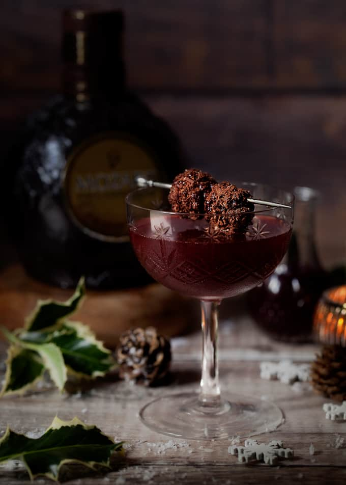 chocolate and bourbon blackberry cocktail with blackberries covered in chocolate flakes