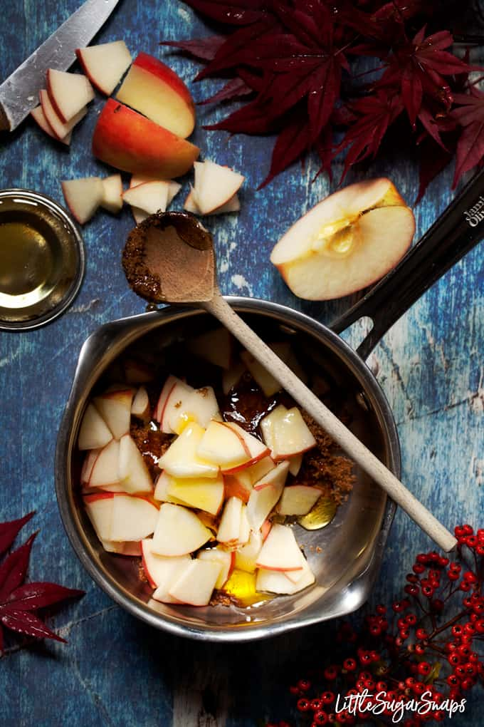 making toffee apple sauce - ingredients including apple, butter, syrup and brown sugar in a pan proir to cooking