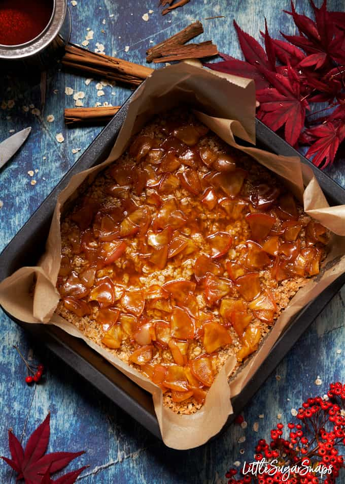 Toffee apple sauce spread over a flapjack base in a baking tin