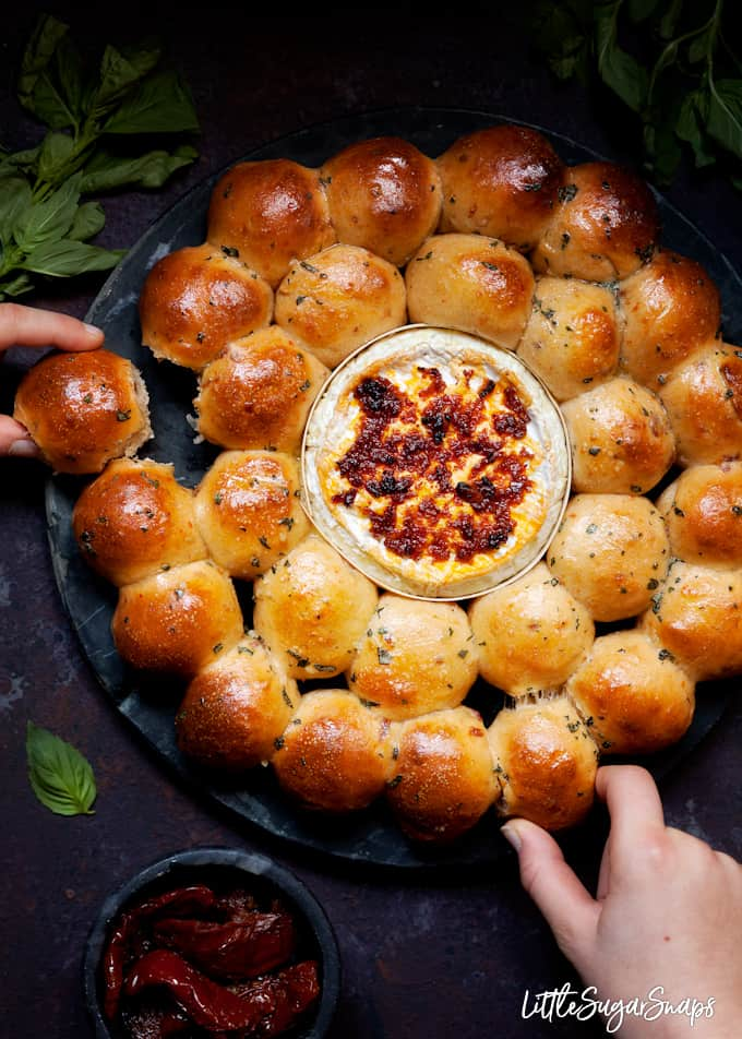 Dough Ball and Baked Camembert Wreath being pulled apart by 2 people