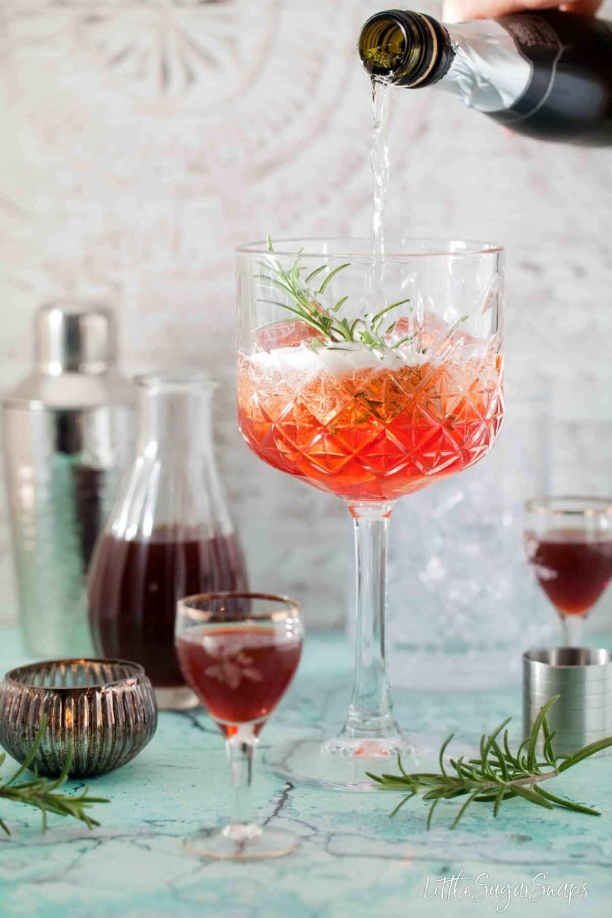 pouring prosecco into a copa glass
