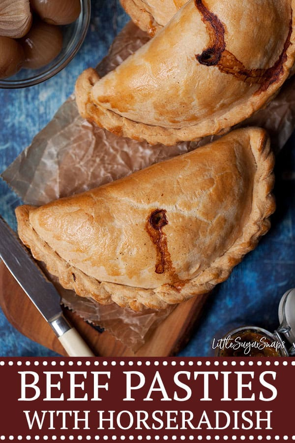 Beef and horseradish pasties on a wooden board - pinterest image