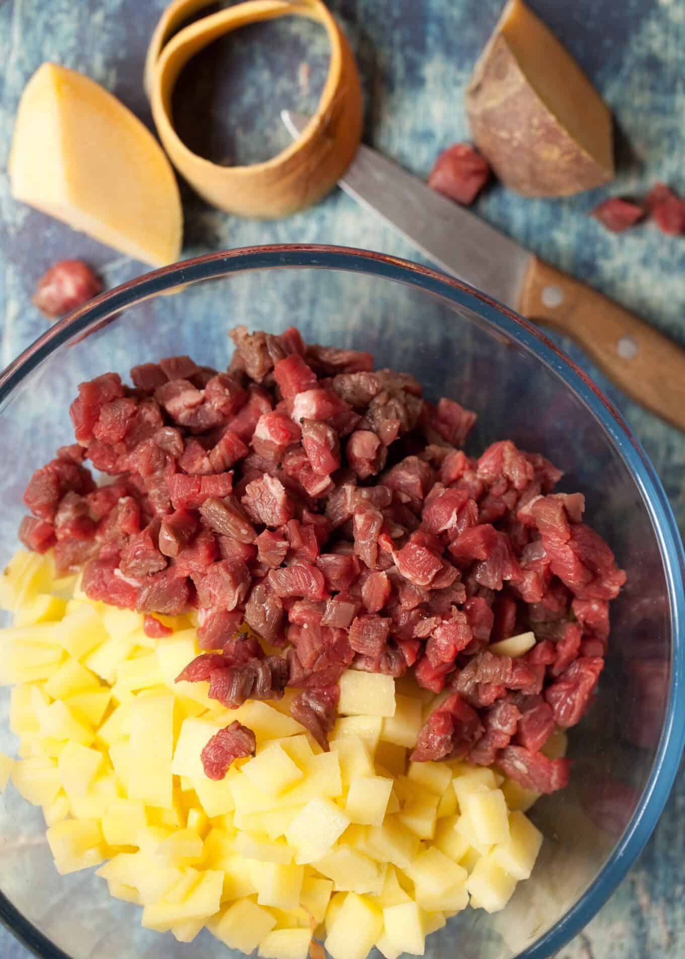 sliced potato and diced beef skirt in a bowl