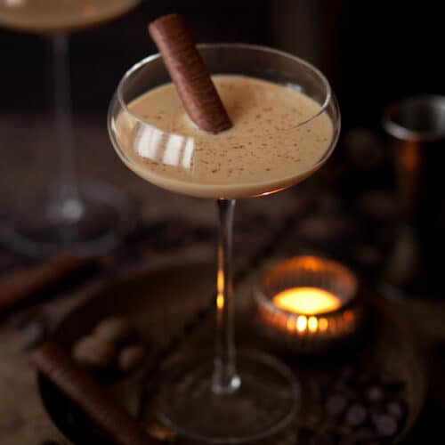 Coffee Brandy Alexander cocktail with a chocolate wafer and chocolate flakes to decorate