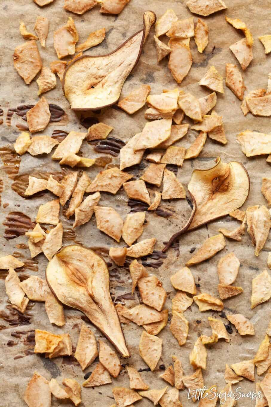 Part baked Pear chunks and wafer thin pear slices on baking parchment