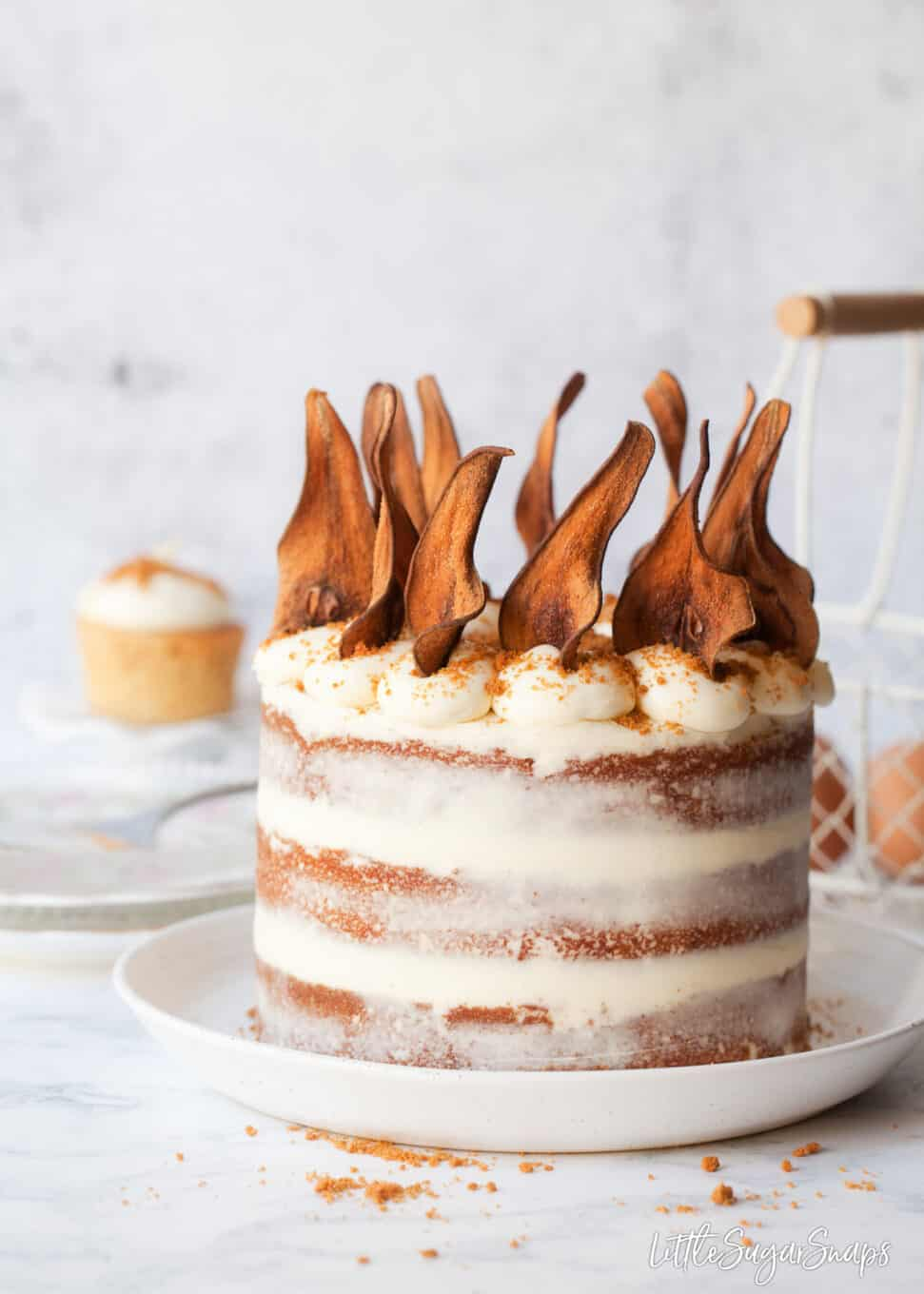 Pear wafers topping a Biscoff cake with white chocolate mascarpone frosting.