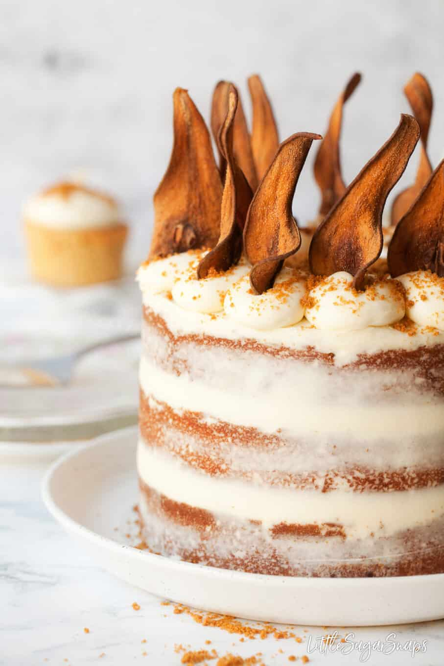 Close up of pear cake recipe with white chocolate frosting and pear wafers