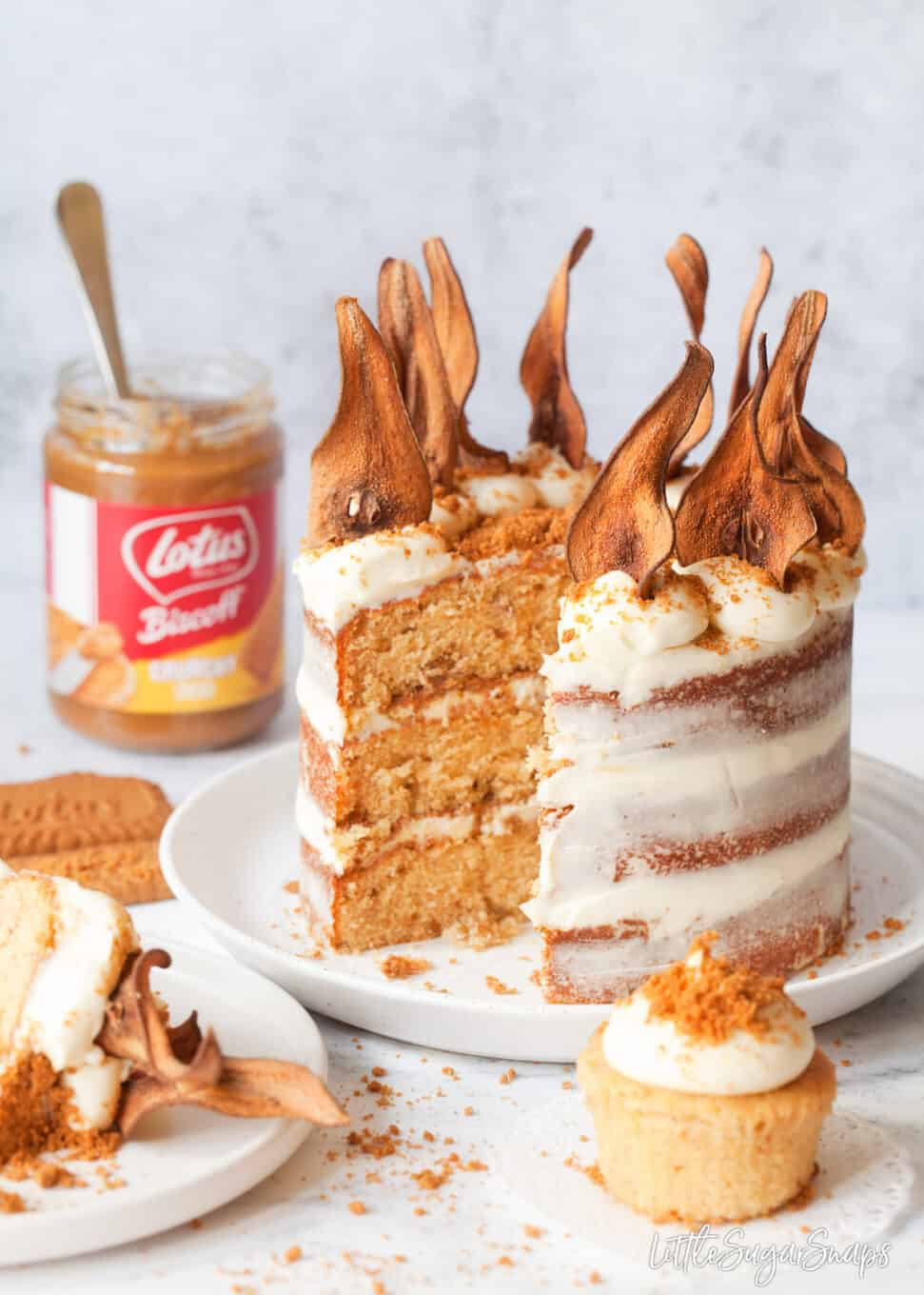 Cut into triple layer Biscoff cake with pear wafers adorning the top.