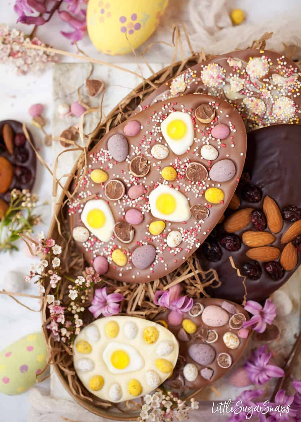 Tray of homemade easter eggs with a variety of toppings.