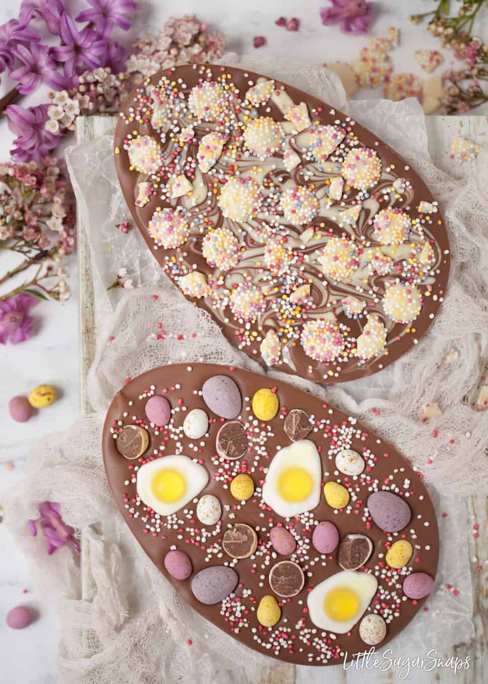 Chocolate eggs topped with mini eggs, sprinkles and jelly sweets.