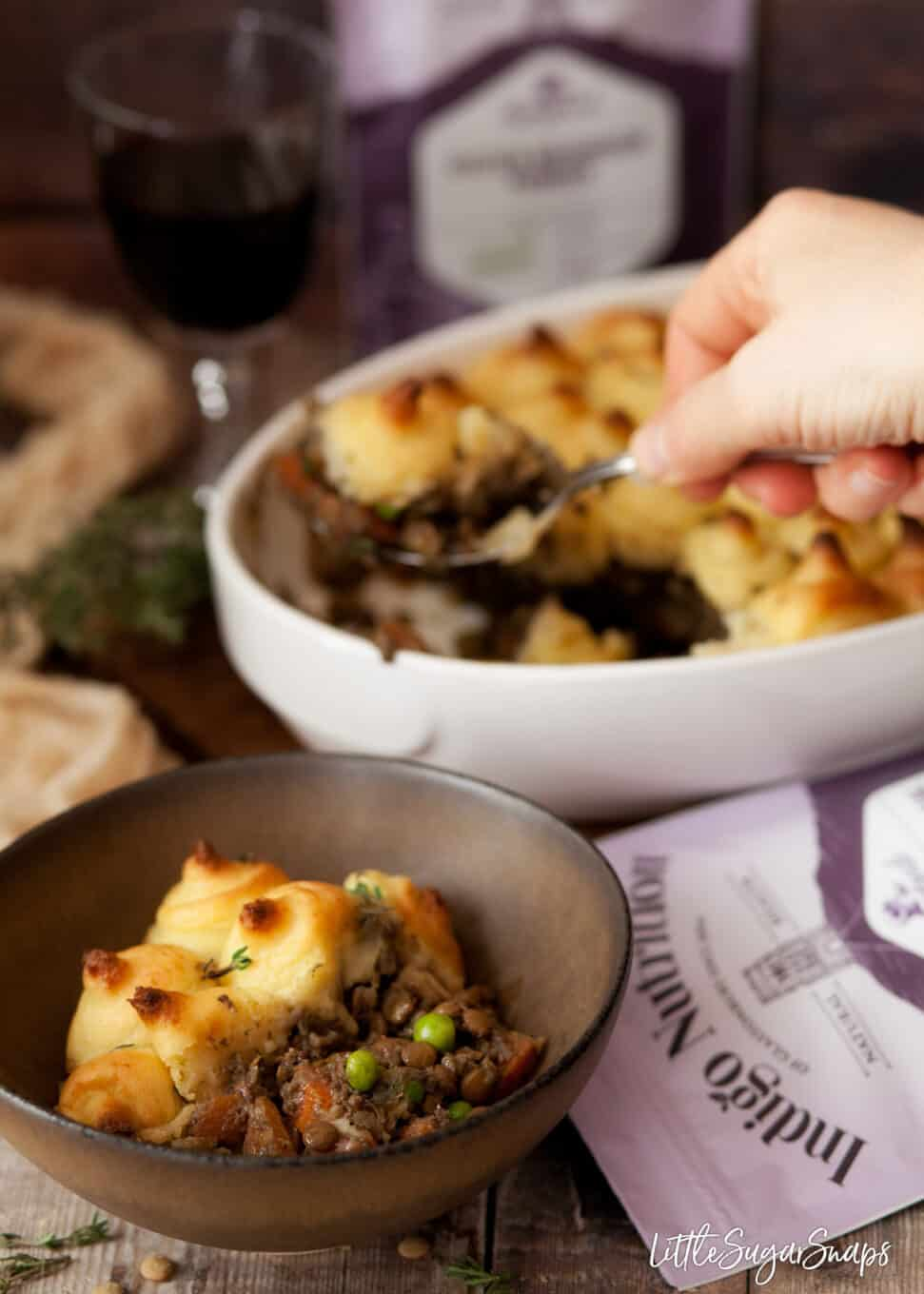 vegan shepherds pie with lentils being served into bowls
