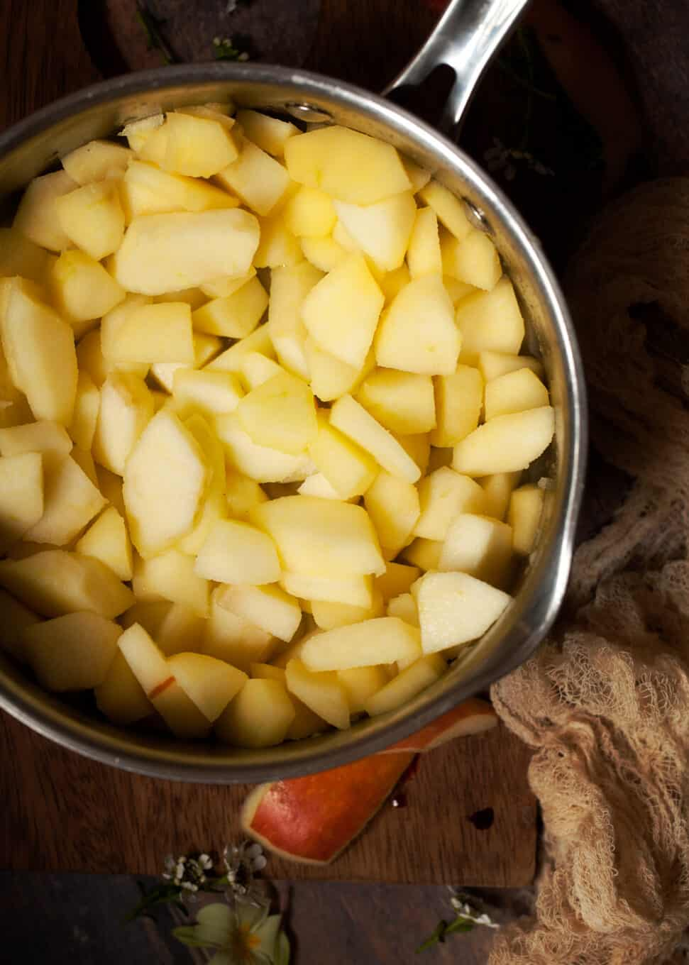 Sliced apples cooked in butter in a large pan