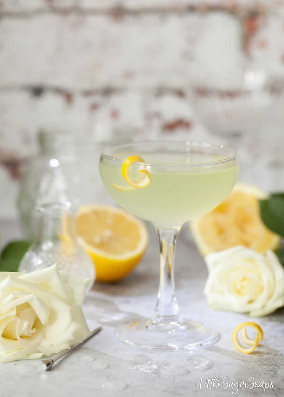 The classic Spring Feeling made with gin, lemon juice and green chartreuse. Garnished with a strip of lemon zest