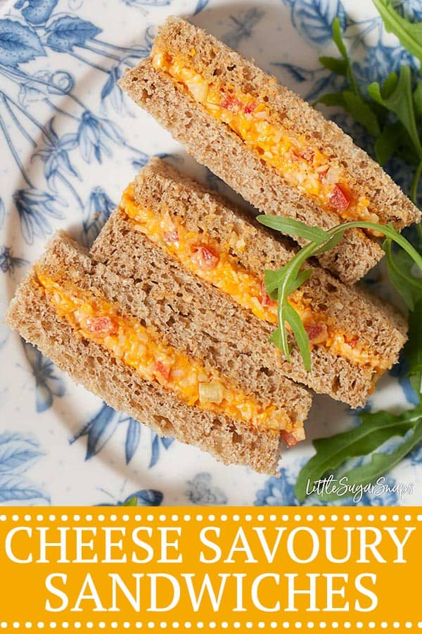 Cheese savoury sandwich cut dainty and small for afternoon tea with a side garnish of rocket leaves