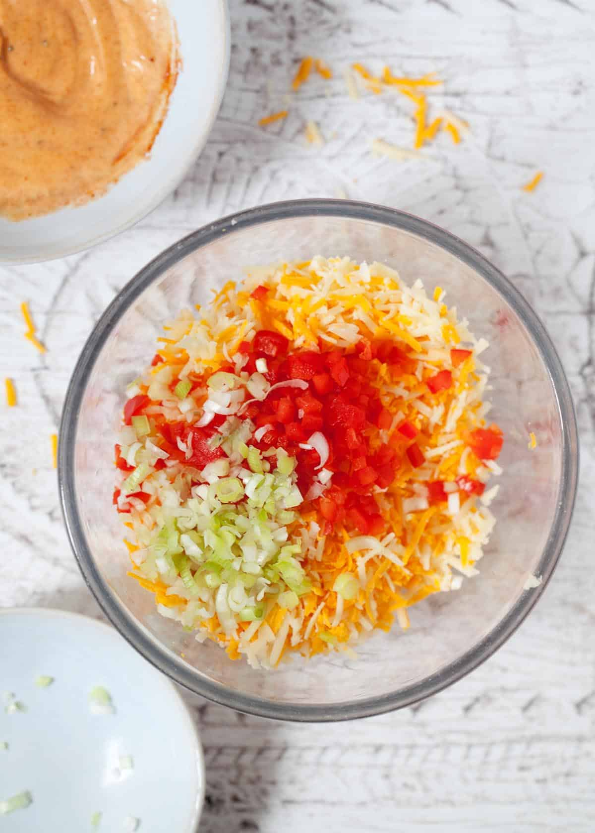 Mixed grated cheese with onion and red pepper