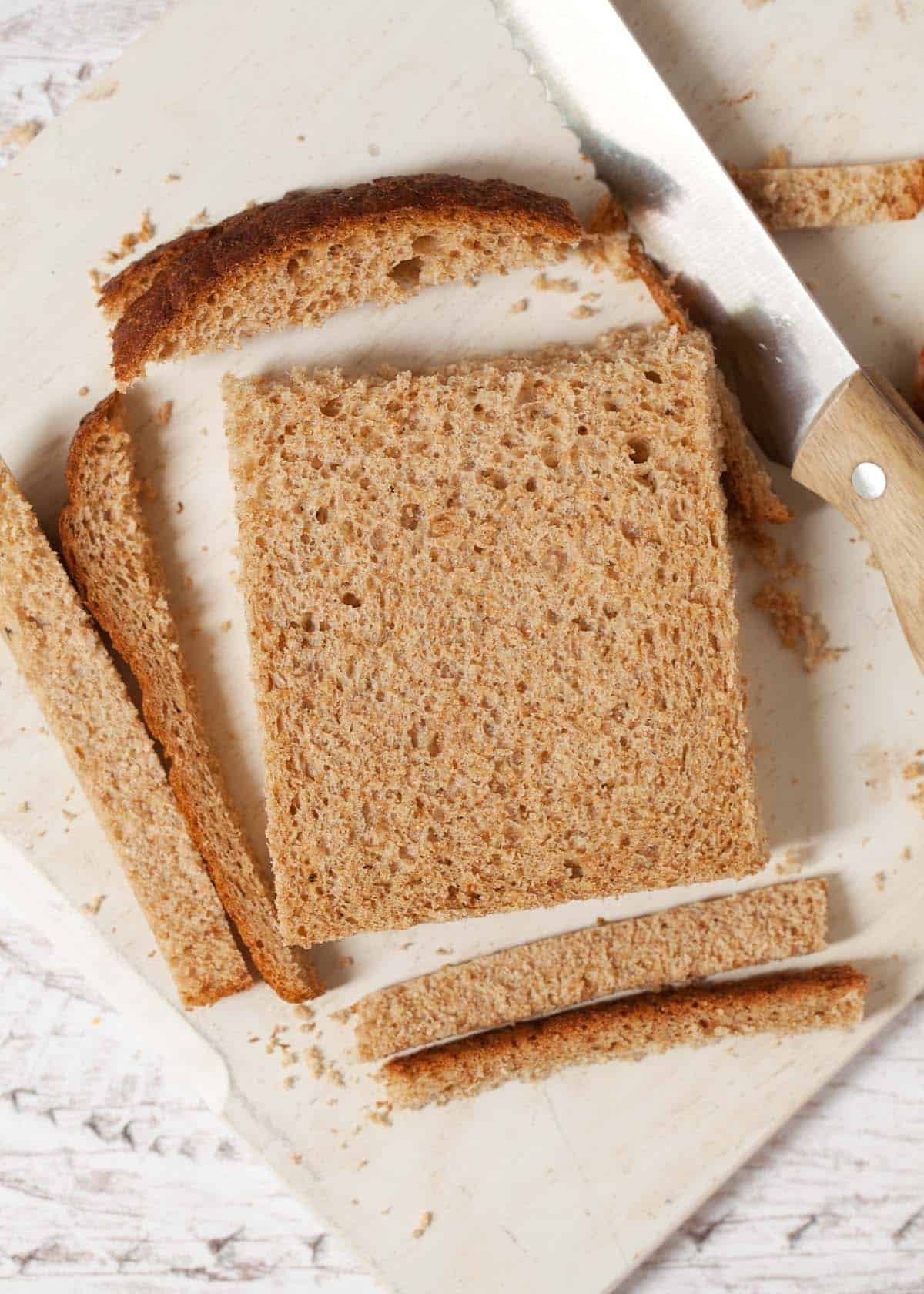 making sandwiches for afternoon tea: step one is cutting off the crusts