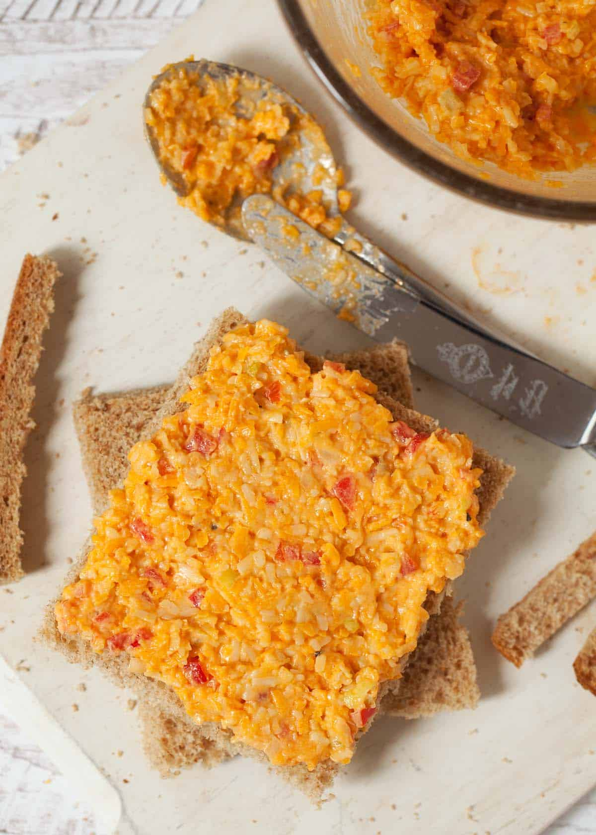 making sandwiches for afternoon tea: step three - spread out the cheese savoury sandwich filling
