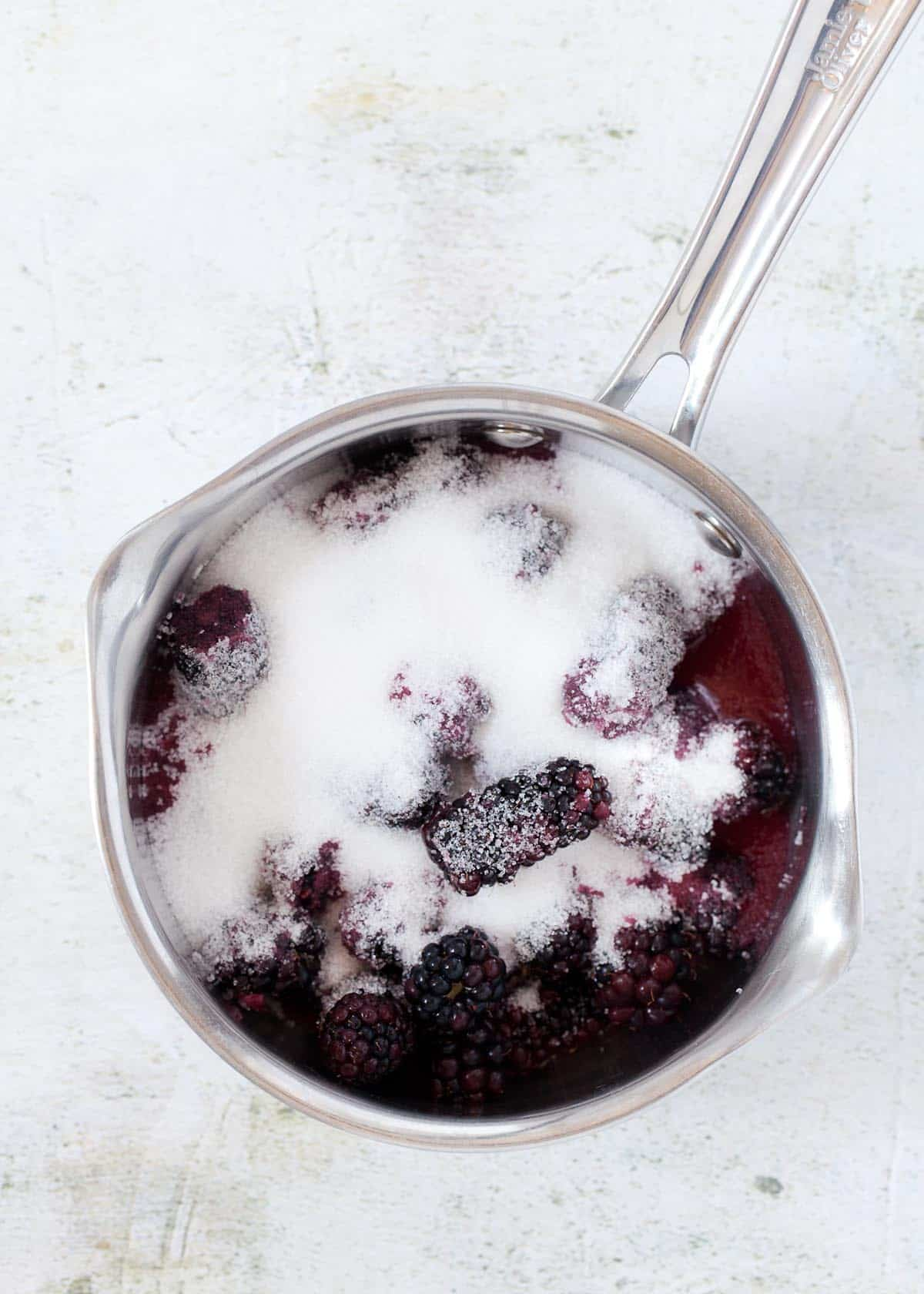 Blackberries and sugar in a saucepan ready to be cooked