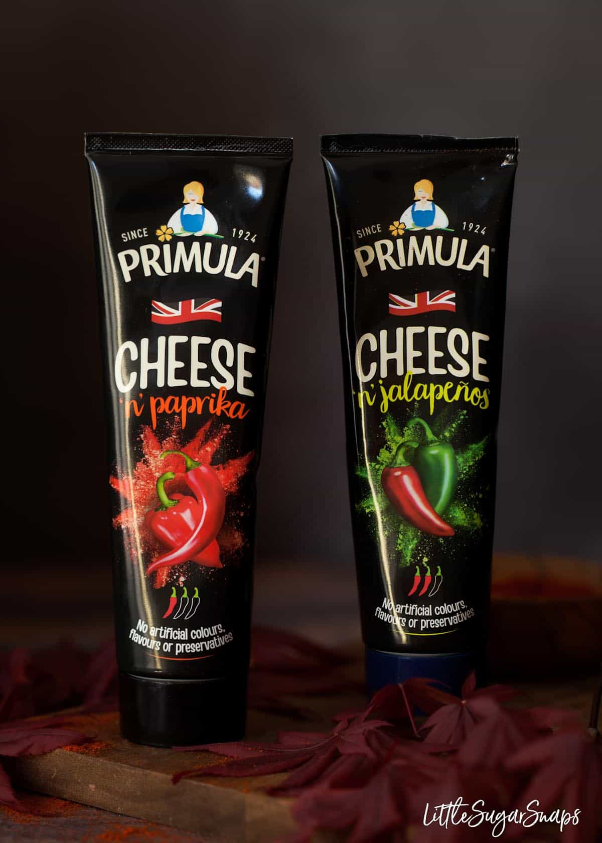 Two tubes of Primula cheese spread - one flavoured with paprika, the other with jalapeno