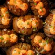 Cheesy Hasselback Potatoes with Bacon, cheese spread, spring onion and paprika