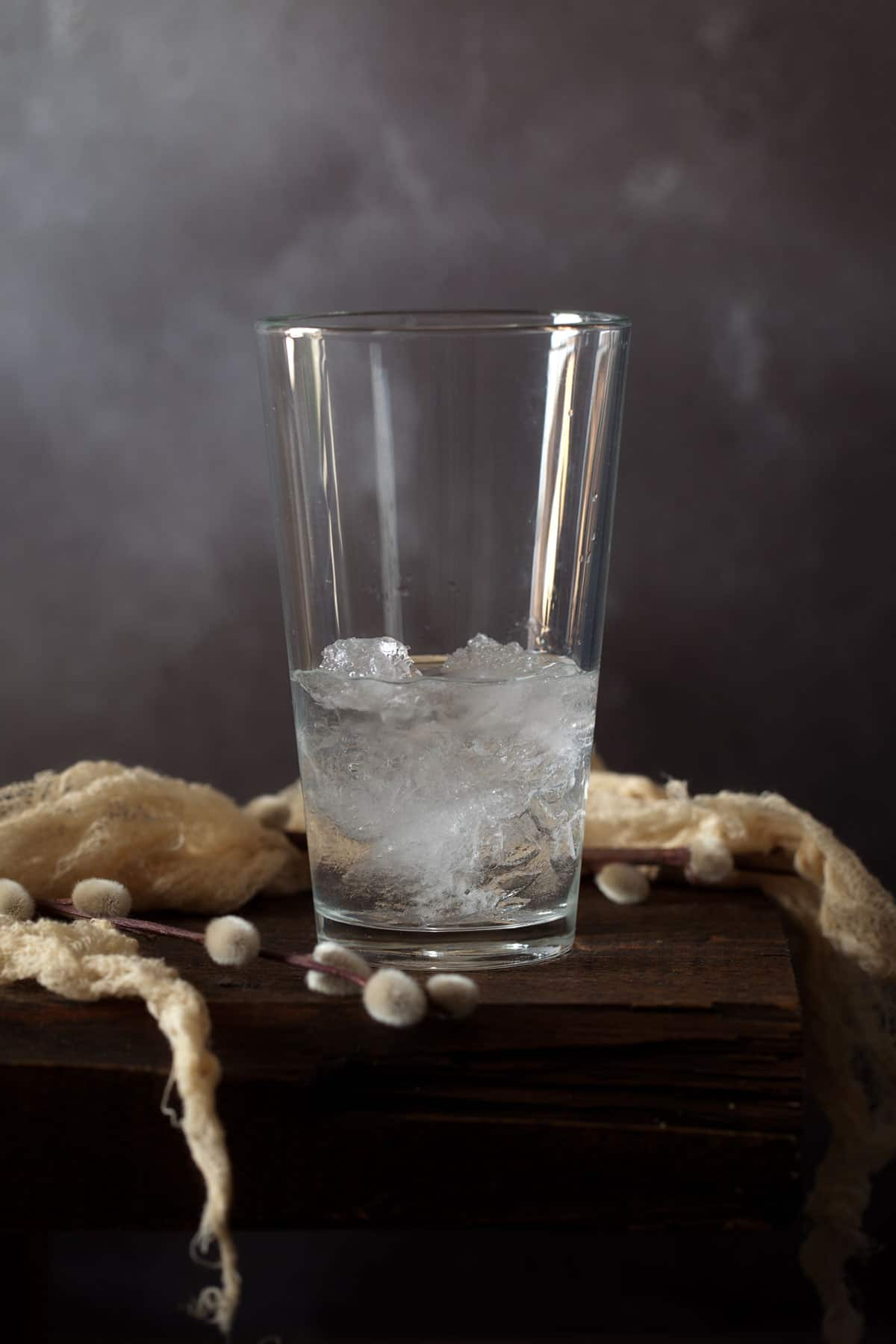 Ingredients for a cocktail in a glass filled with ice