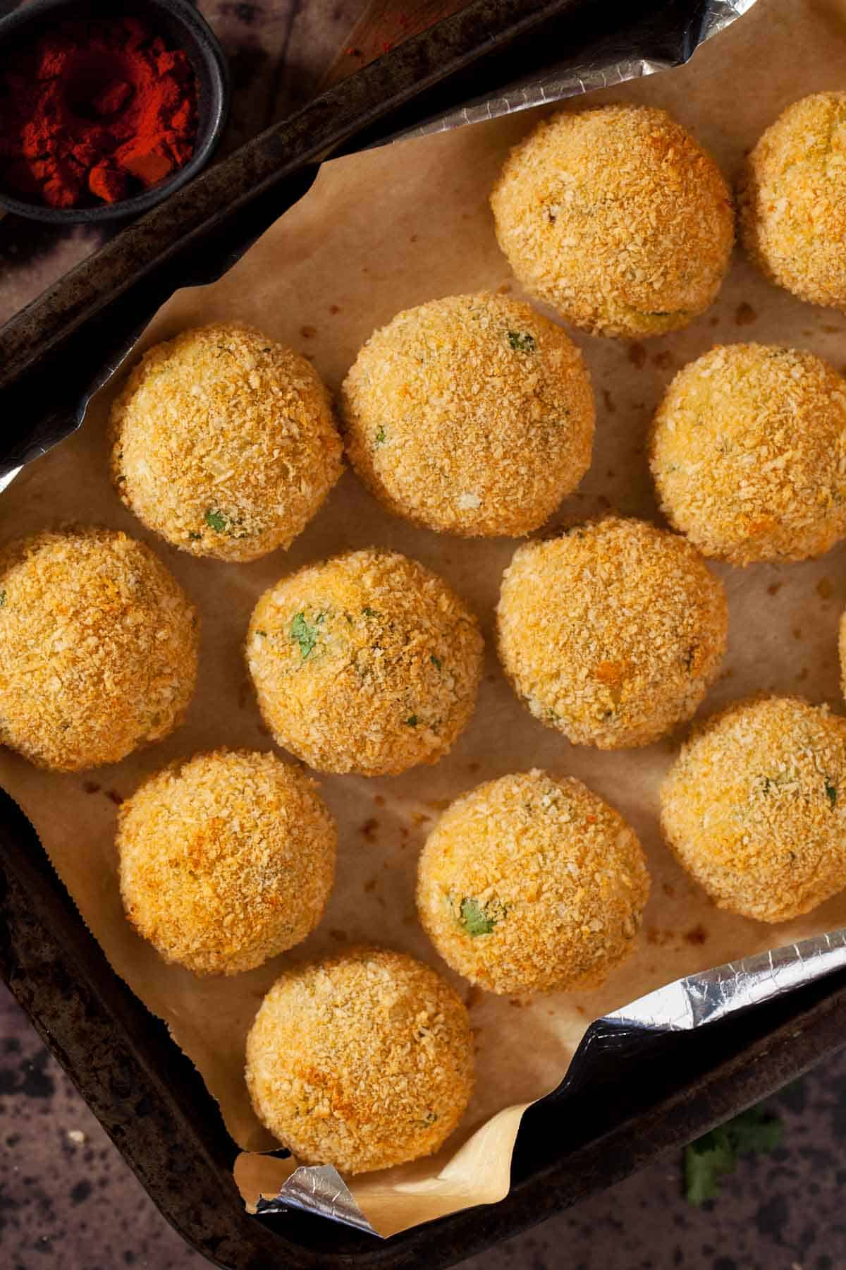 Freshly baked Indian Spiced Smoked Haddock Fish Cakes on a baking tin