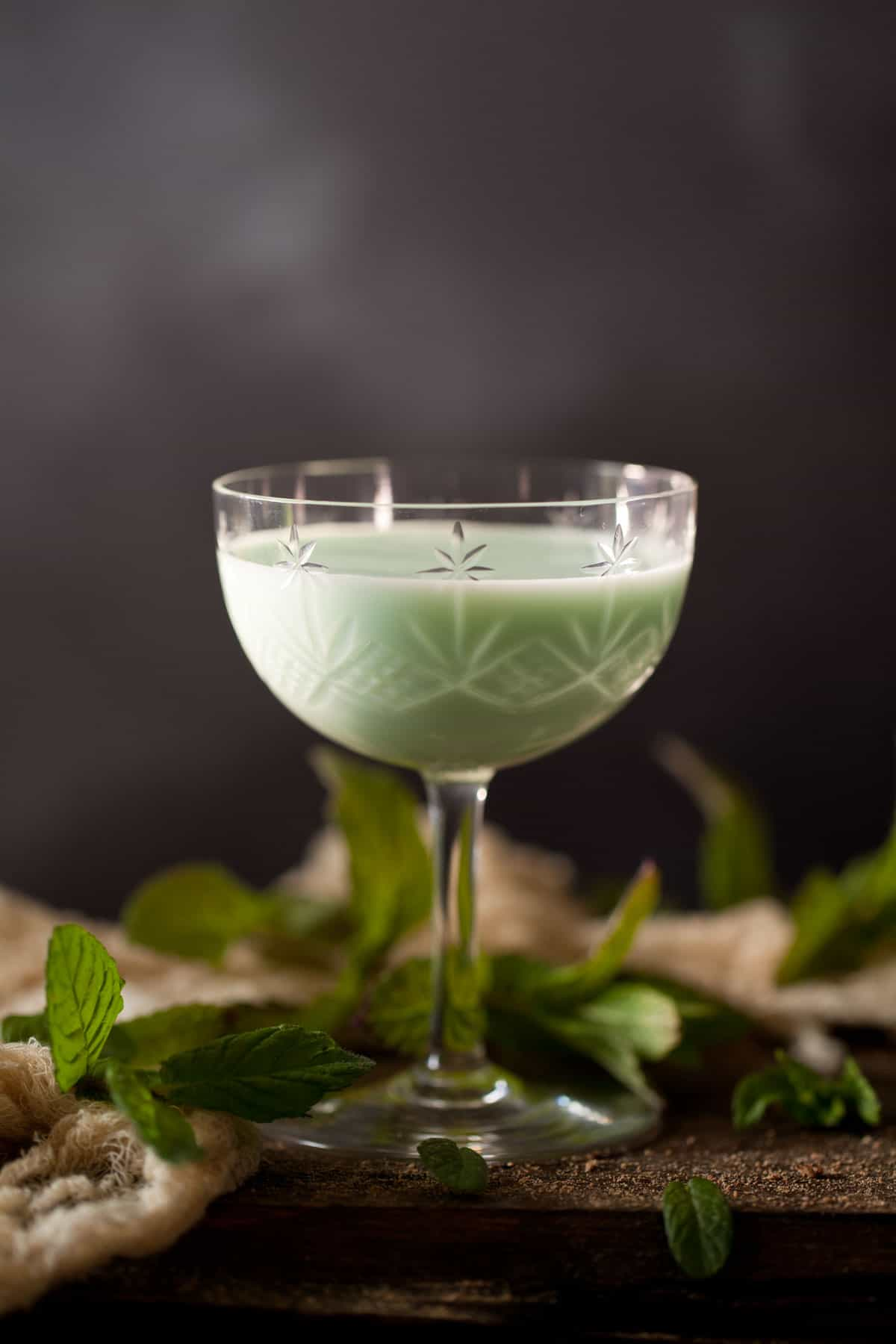 A creamy gin alexander flavoured with green creme de menthe. Served in a vintage cocktail glass