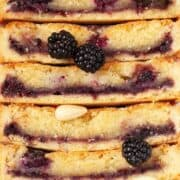 Close up of almond frangipane tart with blackberries