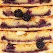 Close up of almond frangipane tart with blackberries